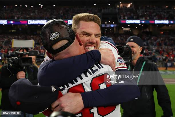 Freddie Freeman and manager Brian Snitker of the Atlanta Braves celebrate after defeating the Los Angeles Dodgers in Game Six of the National League...