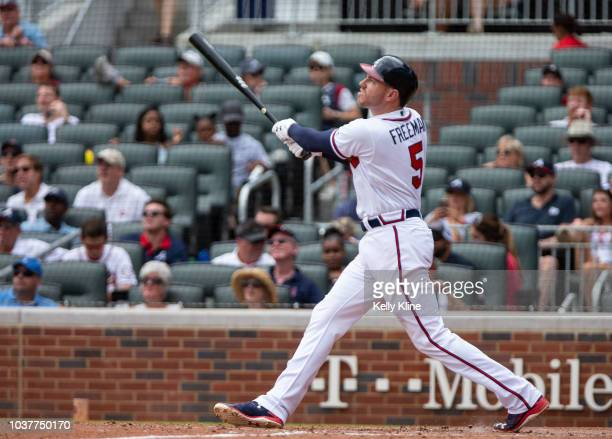 Freddie Freeman for the Atlanta Braves hits a fly ball deep to right field against the Washington Nationals at SunTrust Park on September 15 2018 in...