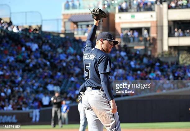 Freddie Freeman of the Atlanta Braves acknowledges the Braves fans during the sixth inning of a game against the Chicago Cubs as the Atlanta Braves...
