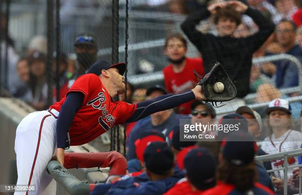 Freddie Freeman of the Atlanta Braves catches a pop fly in foul territory by Carson Kelly of the Arizona Diamondbacks to end the second inning at...