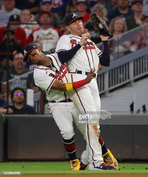Freddie Freeman of the Atlanta Braves catches a pop out by Hunter Renfroe of the Boston Red Sox as Ronald Acuna Jr. #13 collides with him in the...