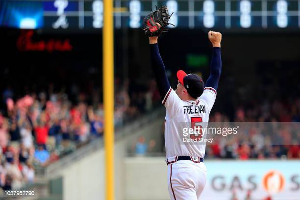 Freddie Freeman of the Atlanta Braves celebrates after clinching the NL East Division against the Philadelphia Phillies at SunTrust Park on September...
