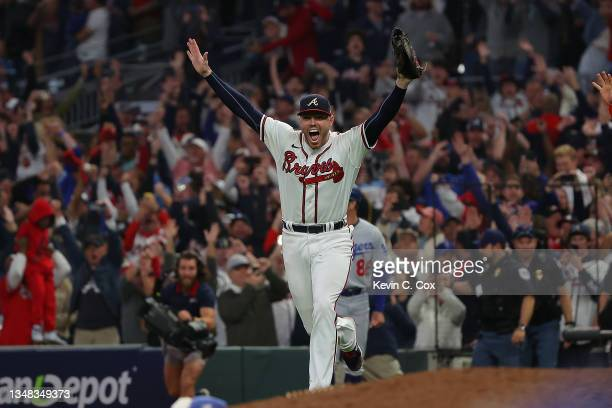 Freddie Freeman of the Atlanta Braves celebrates after defeating the Los Angeles Dodgers in Game Six of the National League Championship Series at...
