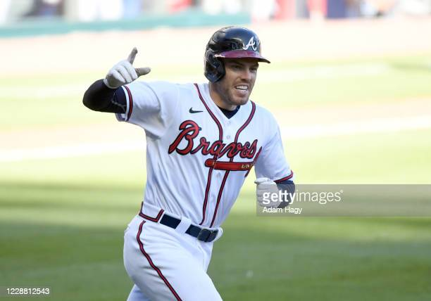 Freddie Freeman of the Atlanta Braves celebrates after hitting a walk-off single to win Game 1 of the Wild Card Series between the Cincinnati Reds...