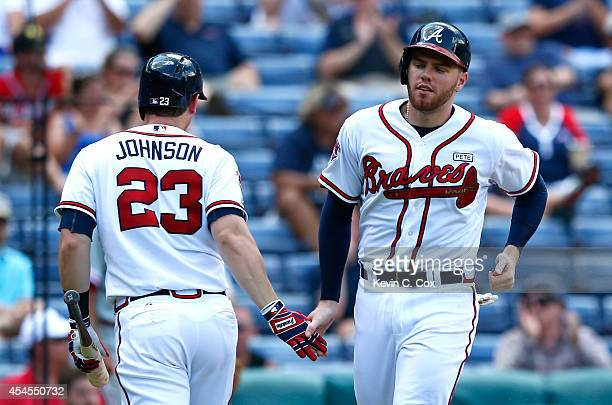Freddie Freeman of the Atlanta Braves celebrates scoring in the sixth inning off a single by Tommy La Stella against the Philadelphia Phillies at...
