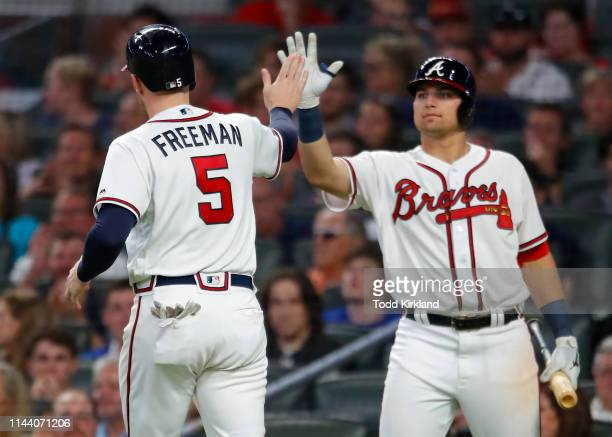 Freddie Freeman of the Atlanta Braves celebrates scoring with Austin Riley in the sixth inning of an MLB game against the St Louis Cardinals at...