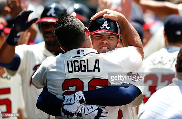 Freddie Freeman of the Atlanta Braves celebrates with Dan Uggla after hitting a threerun homer in the fifth inning against the New York Mets at...