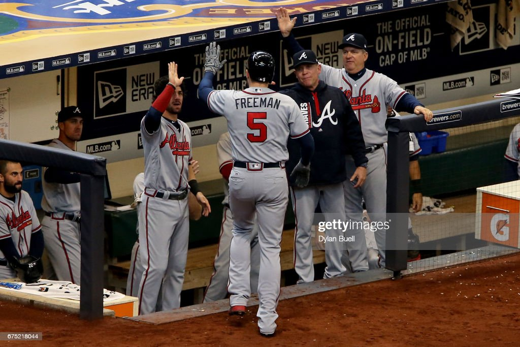 Freddie Freeman #5 of the Atlanta Braves celebrates with teammates after hitting a home run in the sixth inning against the Milwaukee Brewers at Miller Park on April 30, 2017 in Milwaukee, Wisconsin.