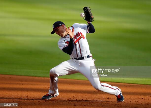 Freddie Freeman of the Atlanta Braves fails to field the ball on a wild hop in the seventh inning of game one of the MLB doubleheader against the New...