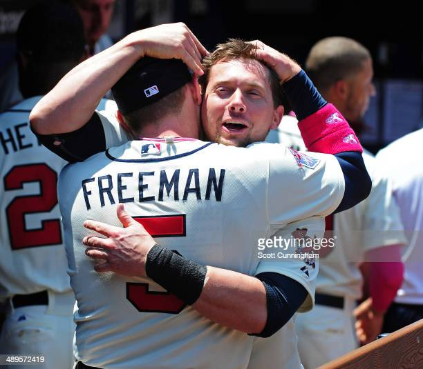 Freddie Freeman of the Atlanta Braves greets Chris Johnson before the game against the Chicago Cubs at Turner Field on May 11, 2014 in Atlanta,...
