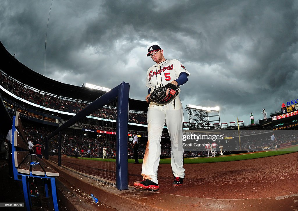 Freddie Freeman #5 of the Atlanta Braves heads off the field after the sixth inning against the Washington Nationals at Turner Field on June 2, 2013 in Atlanta, Georgia.