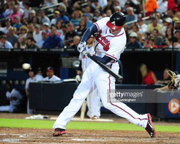 Freddie Freeman of the Atlanta Braves hits a fifth inning home run against the Pittsburgh Pirates at Turner Field on June 3, 2013 in Atlanta, Georgia.