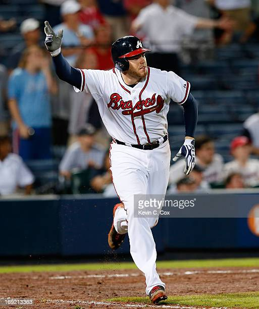 Freddie Freeman of the Atlanta Braves hits a game-winning RBI single in the bottom of the 10th inning to give the Braves a 5-4 win over the Minnesota...