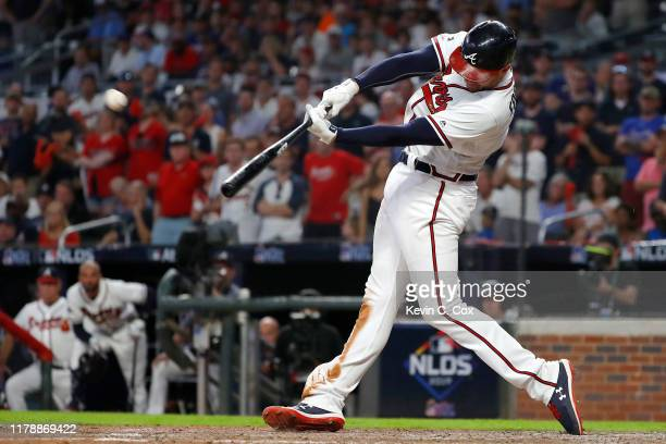 Freddie Freeman of the Atlanta Braves hits a home run against the St. Louis Cardinals during the ninth inning in game one of the National League...