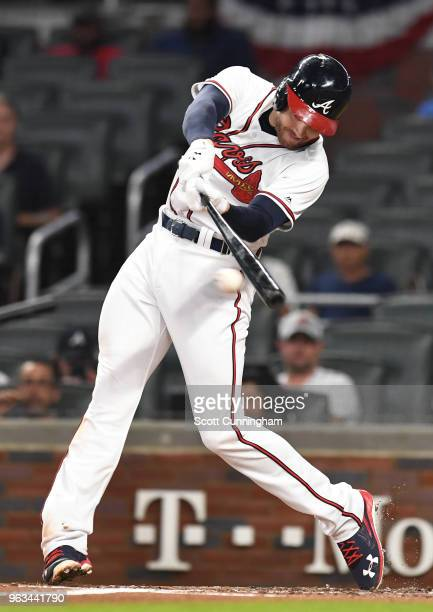 Freddie Freeman of the Atlanta Braves hits a single in the first inning against the New York Mets at SunTrust Field on May 28 2018 in Atlanta Georgia