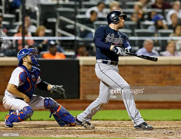 Freddie Freeman of the Atlanta Braves hits a three run home run as Travis d'Arnaud of the New York Mets defends in the ninth inning on September 23,...