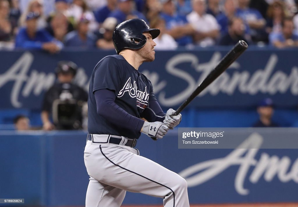 Freddie Freeman #5 of the Atlanta Braves hits a triple in the sixth inning during MLB game action against the Toronto Blue Jays at Rogers Centre on June 19, 2018 in Toronto, Canada.