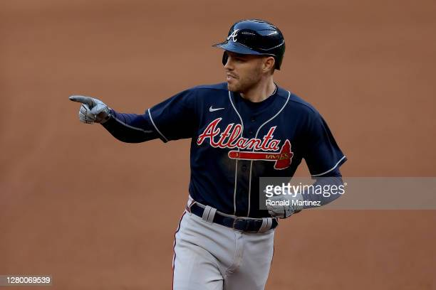 Freddie Freeman of the Atlanta Braves hits a two run home run against the Los Angeles Dodgers during the fourth inning in Game Two of the National...