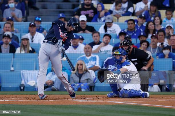 Freddie Freeman of the Atlanta Braves hits a two run home run during the first inning of Game Five of the National League Championship Series against...