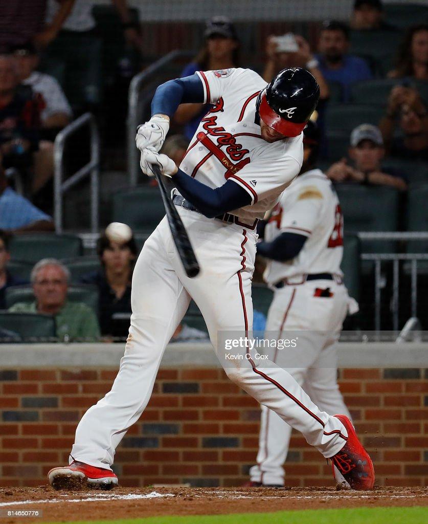 Freddie Freeman #5 of the Atlanta Braves hits a two-RBI single that scored Ender Inciarte #11 and Brandon Phillips #4 in the eighth inning against the Arizona Diamondbacks at SunTrust Park on July 14, 2017 in Atlanta, Georgia.