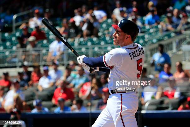 Freddie Freeman of the Atlanta Braves hits a tworun home run during the fourth inning against the St Louis Cardinals at SunTrust Park on September 19...