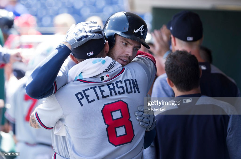 Freddie Freeman #5 of the Atlanta Braves hugs Jace Peterson #8 after hitting a two run home run in the top of the first inning against the Philadelphia Phillies in game one of the doubleheader at Citizens Bank Park on August 30, 2017 in Philadelphia, Pennsylvania. The Braves defeated the Phillies 9-1.