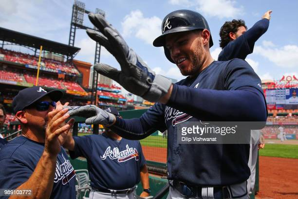 Freddie Freeman of the Atlanta Braves is congratulated after hitting a tworun home run against the St Louis Cardinals in the sixth inning at Busch...