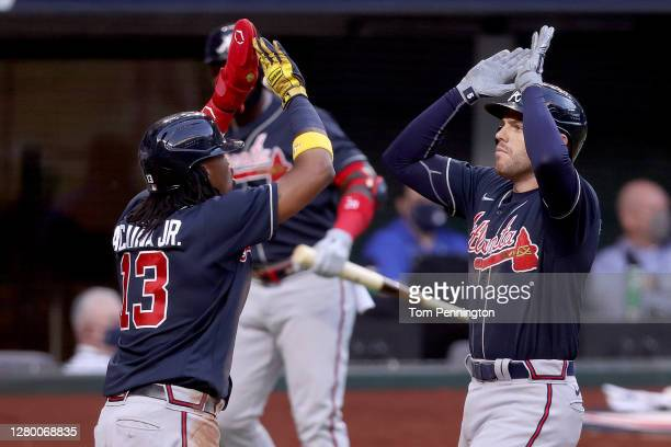 Freddie Freeman of the Atlanta Braves is congratulated by Ronald Acuna Jr. #13 after hitting a two run home run against the Los Angeles Dodgers...