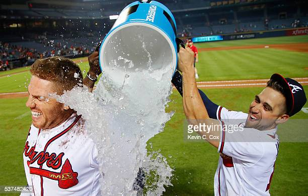 Freddie Freeman of the Atlanta Braves is dunked by Adonis Garcia and Ender Inciarte after his walkoff homer in their 54 win over the San Francisco...