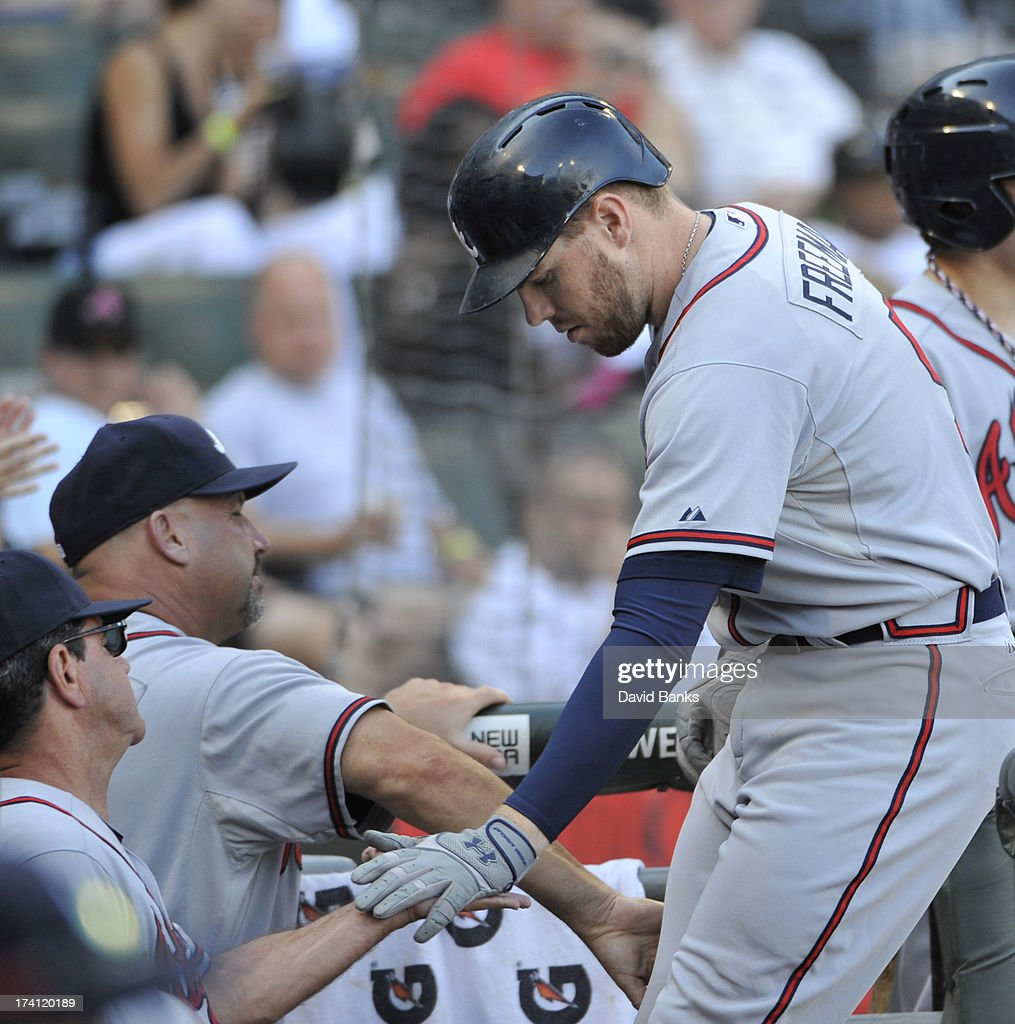 Freddie Freeman #5 of the Atlanta Braves is greeted by his teammates and coaches after hitting a two-run homer against the Chicago White Sox during the eighth inning on July 20, 2013 at U.S. Cellular Field in Chicago, Illinois. The Chicago White Sox defeated the Atlanta Braves 10-6.