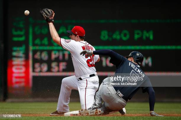 Freddie Freeman of the Atlanta Braves is safe at second base against Daniel Murphy of the Washington Nationals after hitting a double to left in the...