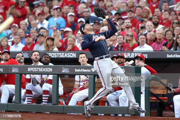 Freddie Freeman of the Atlanta Braves makes a catch in foul territory to retire the side against the St. Louis Cardinals during the fifth inning in...