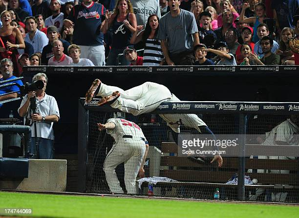 Freddie Freeman of the Atlanta Braves makes a catch of a foul fly over the railing against the St Louis Cardinals at Turner Field on July 28 2013 in...
