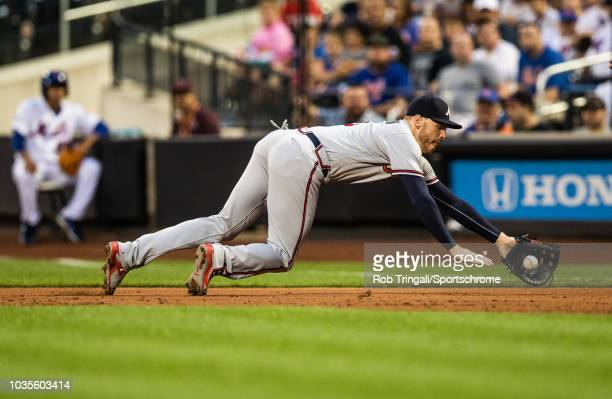 Freddie Freeman of the Atlanta Braves makes a diving grab during the game against the New York Mets at Citi Field on Thursday August 2 2018 in the...