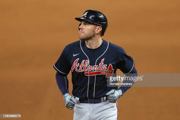 Freddie Freeman of the Atlanta Braves reacts after flying out to Mookie Betts of the Los Angeles Dodgersduring the fifth inning in Game Seven of the...