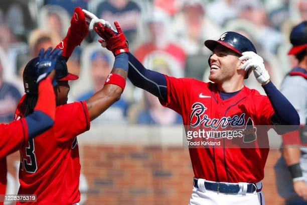 Freddie Freeman of the Atlanta Braves reacts after hitting a grand slam in the sixth inning of an MLB game against the Washington Nationals at Truist...