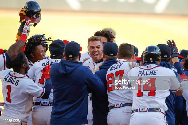 Freddie Freeman of the Atlanta Braves reacts after hitting a single to bring in the winning run in the thirteenth inning of Game One of the National...