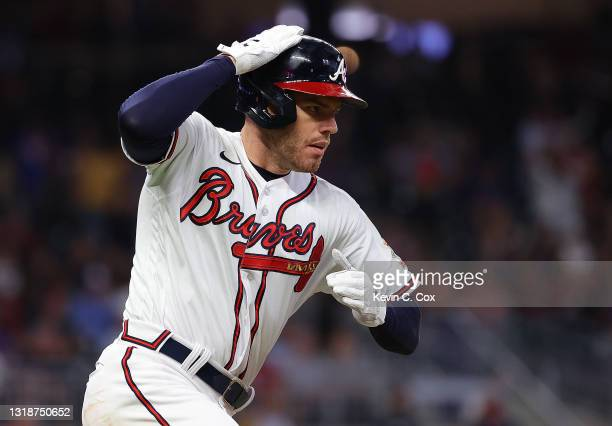 Freddie Freeman of the Atlanta Braves reacts after hitting a solo homer in the sixth inning against the New York Mets at Truist Park on May 18, 2021...