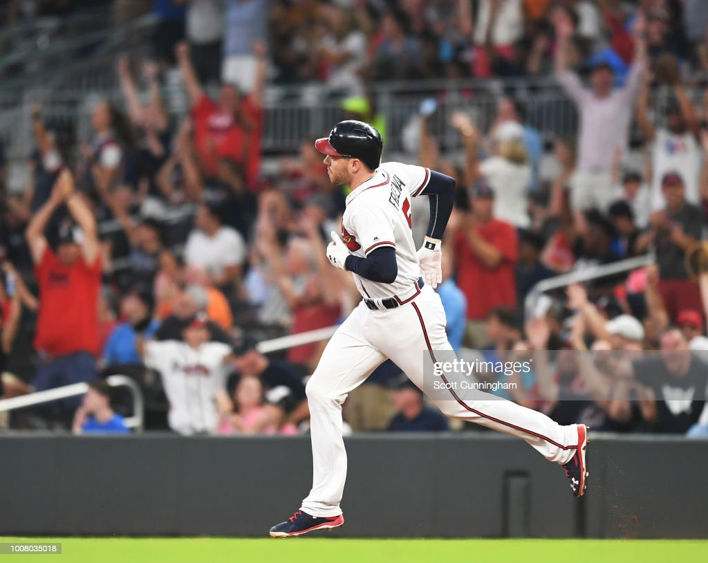 Freddie Freeman #5 of the Atlanta Braves rounds the bases after hitting a third inning solo home run against the Miami Marlins at SunTrust Park on July 30, 2018 in Atlanta, Georgia.