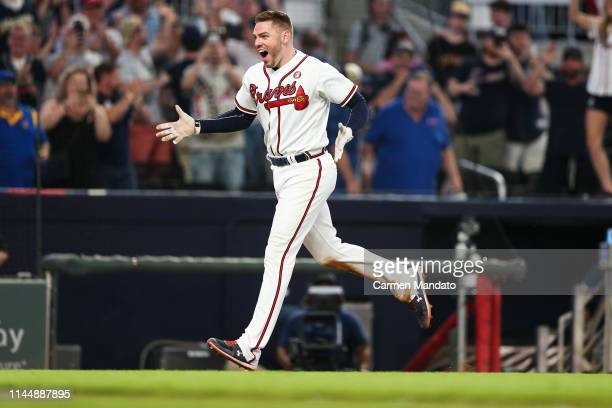 Freddie Freeman of the Atlanta Braves runs the bases after hitting a walk off home run in the tenth inning during the game against the Milwaukee...