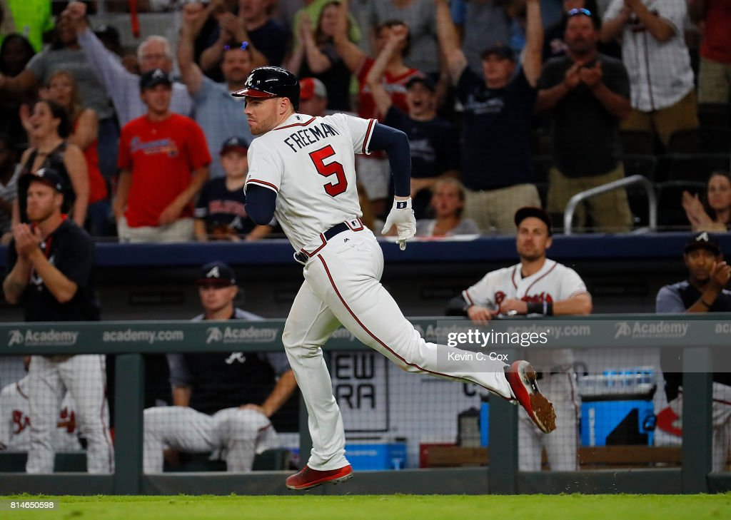 Freddie Freeman #5 of the Atlanta Braves runs to first on a two-RBI single that scored Ender Inciarte #11 and Brandon Phillips #4 in the eighth inning against the Arizona Diamondbacks at SunTrust Park on July 14, 2017 in Atlanta, Georgia.
