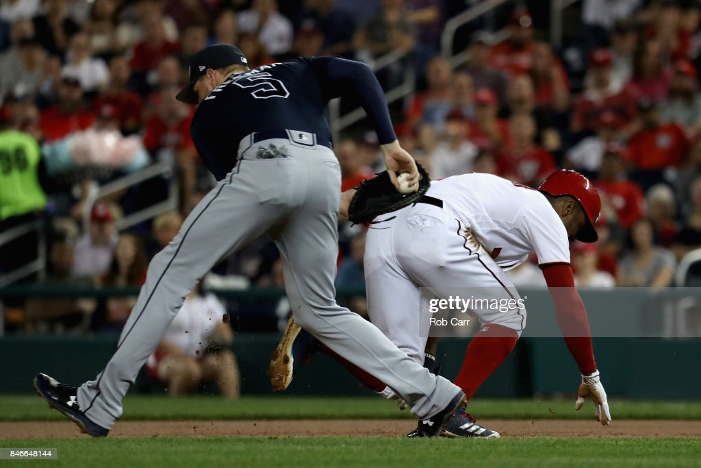Freddie Freeman #5 of the Atlanta Braves tags out Michael Taylor #3 of the Washington Nationals trying to steal second base in the second inning at Nationals Park on September 13, 2017 in Washington, DC.