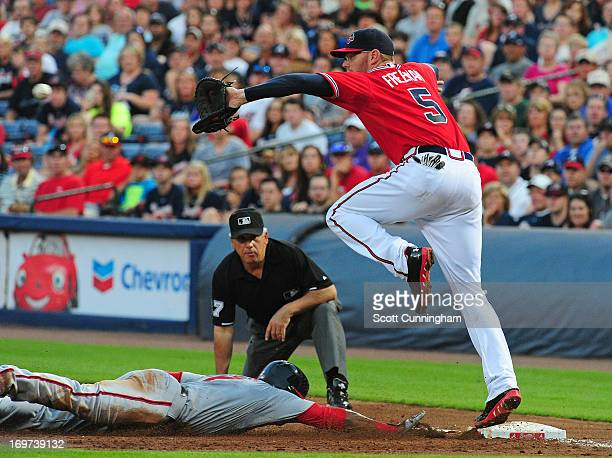 Freddie Freeman of the Atlanta Braves takes a throw at first base to force out Denard Span of the Washington Nationals at Turner Field on May 31 2013...
