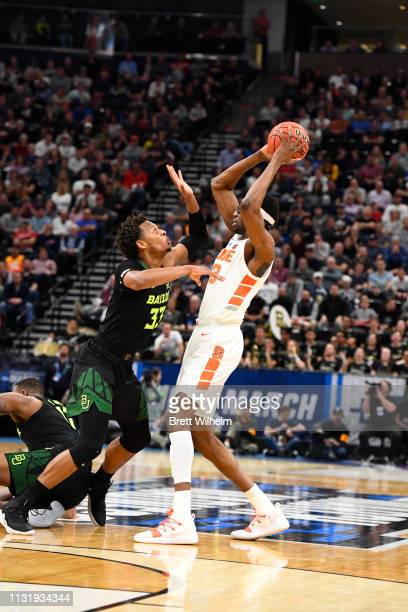 Freddie Gillespie of the Baylor Bears defends Paschal Chukwu of the Syracuse Orange during the game between the Syracuse Orange and the Baylor Bears...
