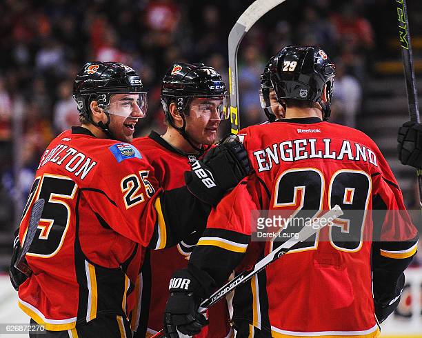 Freddie Hamilton of the Calgary Flames celebrates with his team after scoring against the Toronto Maple Leafs during an NHL game at Scotiabank...