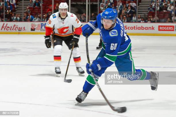 Freddie Hamilton of the Calgary Flames looks on as Markus Granlund of the Vancouver Canucks takes a shot during their NHL game at Rogers Arena...