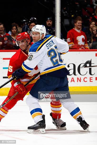 Freddie Hamilton of the Calgary Flames skates against Alex Steen of the St Louis Blues during an NHL game on October 22 2016 at the Scotiabank...
