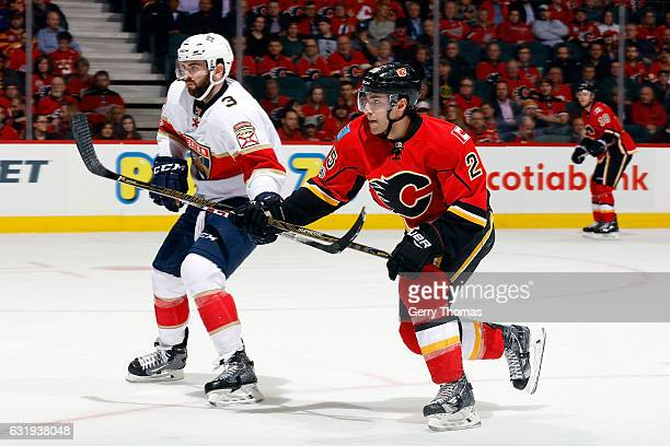 Freddie Hamilton of the Calgary Flames skates against Keith Yandle of the Florida Panthers during an NHL game on January 17 2017 at the Scotiabank...