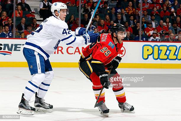 Freddie Hamilton of the Calgary Flames skates against Tyler Bozak of the Toronto Maple Leafs during an NHL game on November 30 2016 at the Scotiabank...