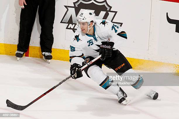 Freddie Hamilton of the San Jose Sharks skates with the puck against the Minnesota Wild during the game on December 8 2013 at the Xcel Energy Center...